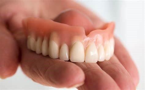 How to fix broken dentures